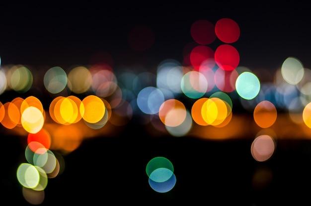 Urban city night light bokeh, defocused blur background
