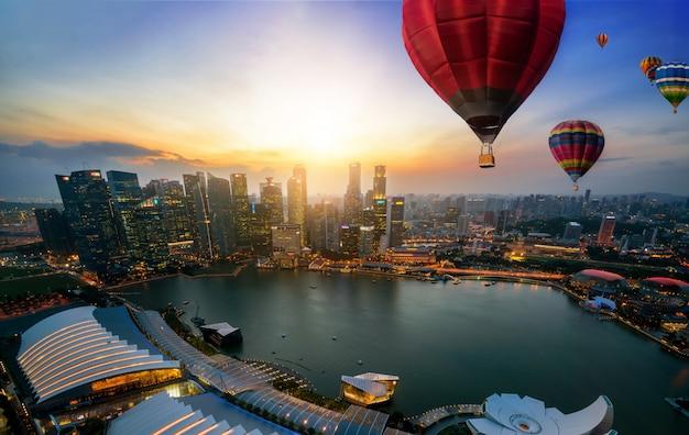Urban cityscape with hot air balloon festival.