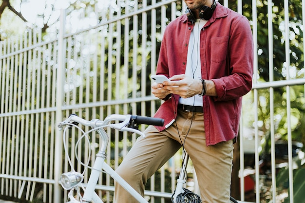 Urban cyclist listening to music
