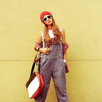 Urban fashion style girl. go to university. bright autumn.