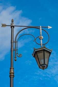 Urban lantern vintage on blue sky background with cloud. city environment theme
