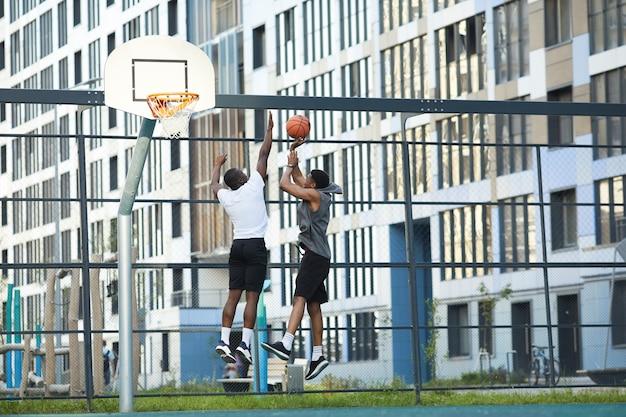Urban people playing basketbll