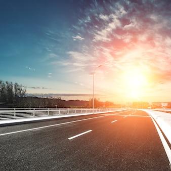 Urban road at sunset