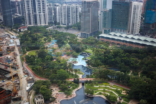 Urban views of kuala lumpur with tall skyscrapers, drowning in the greenery of parks