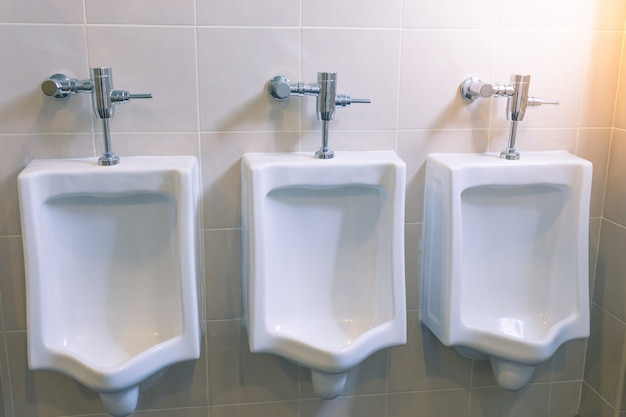 Urinals for men in the male bathroom