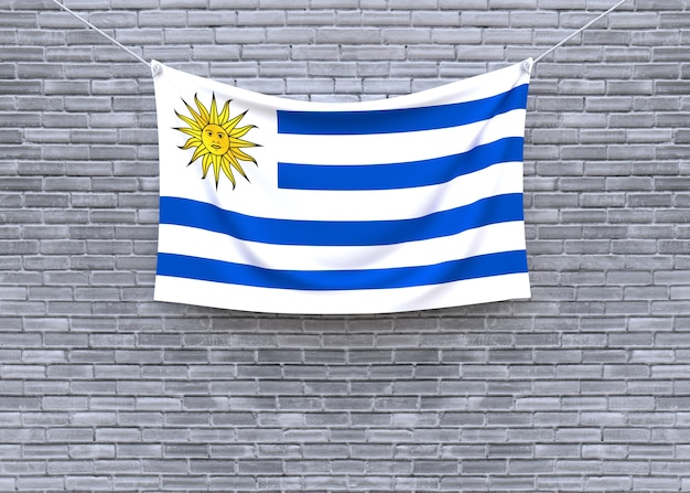 Uruguay flag hanging on brick wall