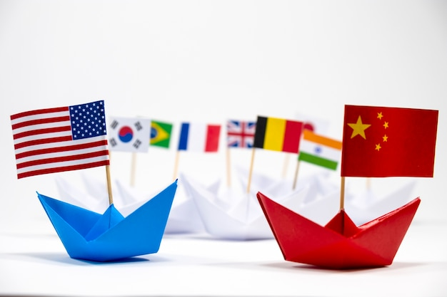Us america flag on blue ship and china flag on red ship with white background of war trade