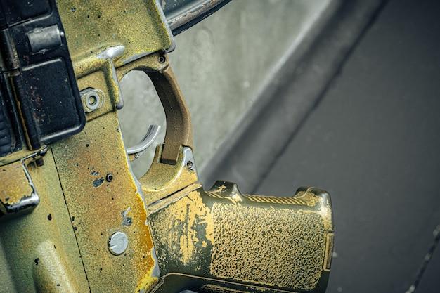 Us army green assault rifle trigger close up