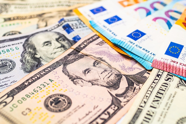 Us dollar banknotes and euro banknotes for foreign exchange concept
