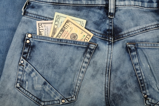 Us dollar banknotes in jeans back pocket