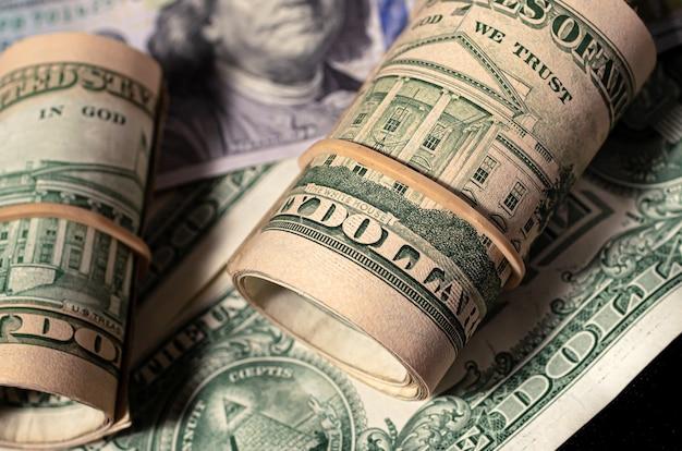 Us dollar bills in closeup in dark environment Premium Photo