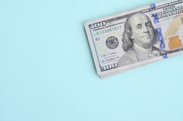 Us dollar bills of a new design with a blue stripe in the middle is lies