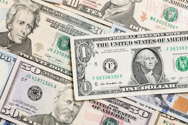 Us dollar bills. one hundred dollar bills background. top view of business  on background with copyspace