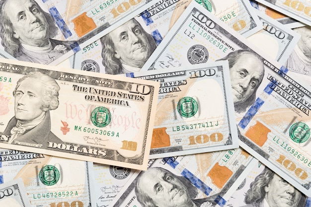 Us dollar bills. one hundred dollar bills background. top view of business concept on background with copy space.