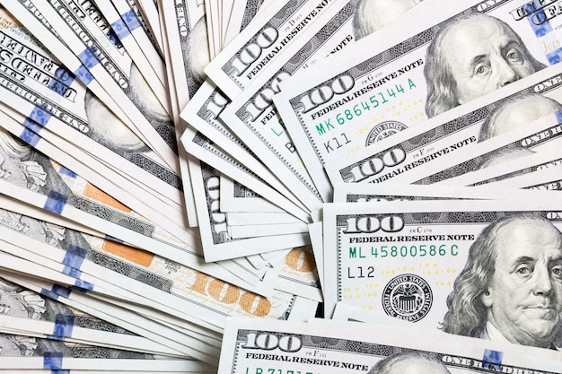Us dollar bills. one hundred dollar bills surface. top view on background with copy space.