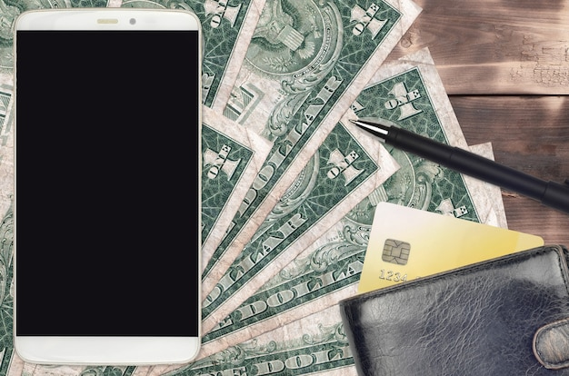 Us dollar bills and smartphone with purse and credit card