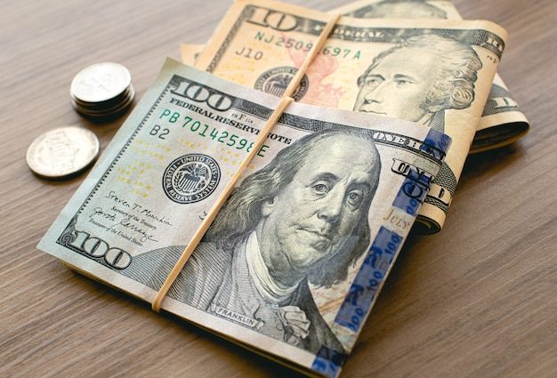 Us dollar bills on wooden furniture in closeup photography