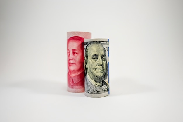 Us dollar and china yuan banknote roll stand up