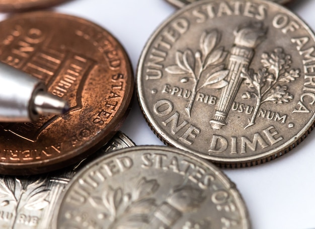 Us dollar coins in closeup photography