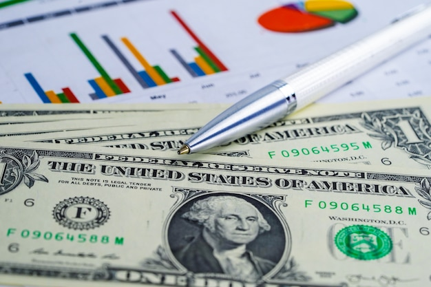 Us dollar and euro banknotes money on chart graph background paper.