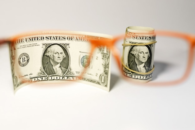 Us dollars are viewed through glasses