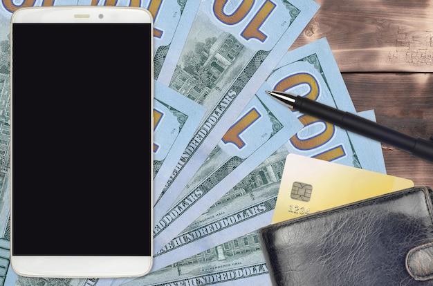 Счета долларов сша и смартфон с кошельком и кредитной картой