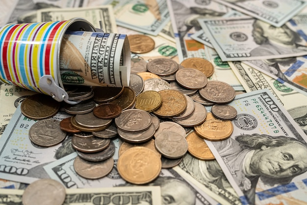 Us dollars and coins for currency exchange as background for design