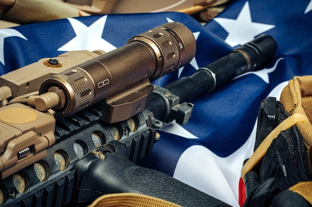 Us flag and assault rifle close up
