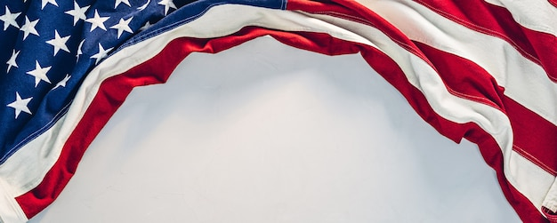Us flag with copy space on light gray concrete texture