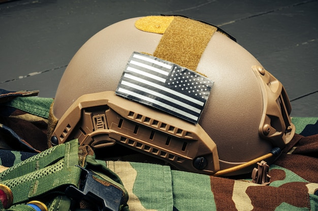 Us military helmet on wooden background close up