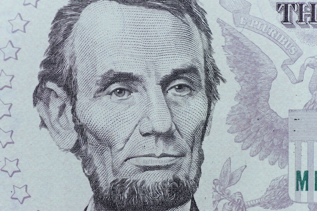 Us president abraham lincoln face on five dollar bill macro, five usd, united states money closeup