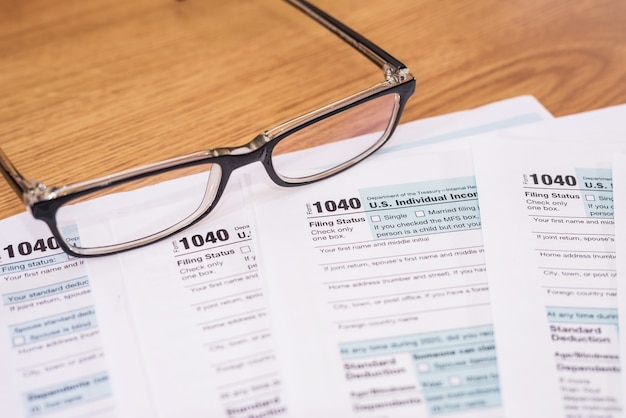 Us tax form 1040 with eyeglasses. financial concept.