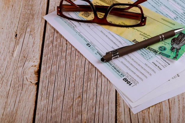 Usa 1040 tax form with glasses an financial office