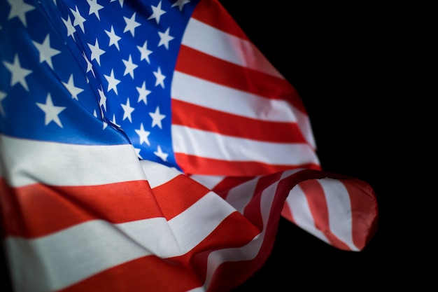 Usa american flag blowing in the wind on black