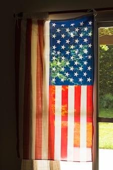 Usa american flag hang on the glass window