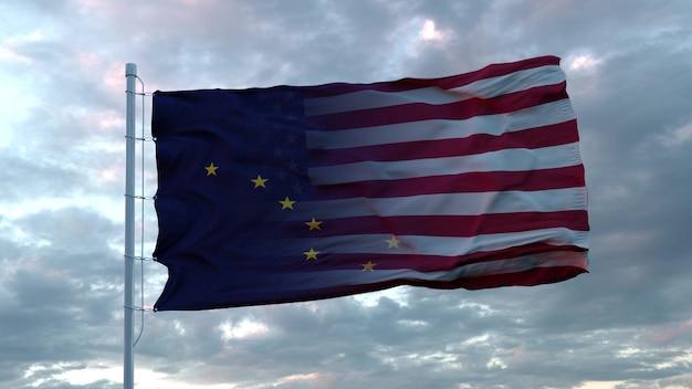 風に揺れるアメリカとアラスカの混合旗