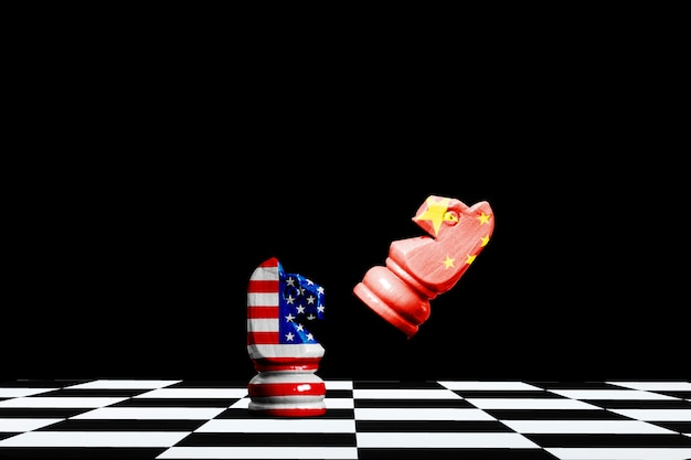 Usa and china flag print screen on horse chess with black.