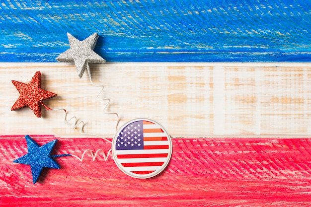 Usa flag badges and stars on red and blue painted wooden textured backdrop