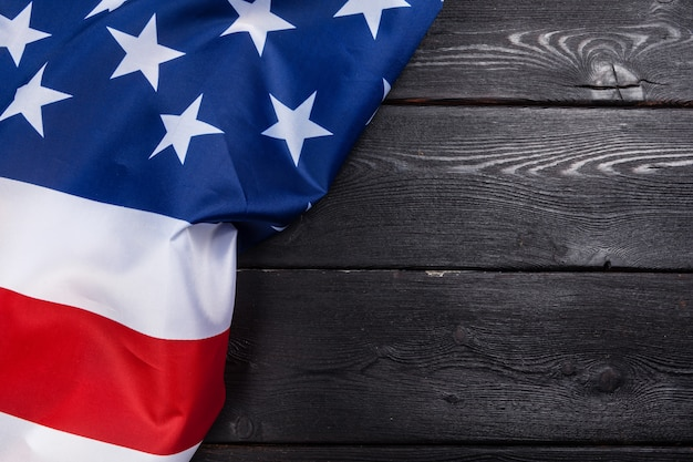 Usa flag on dark wooden table background