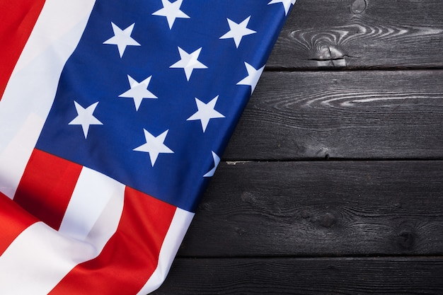 Usa flag on dark wooden table