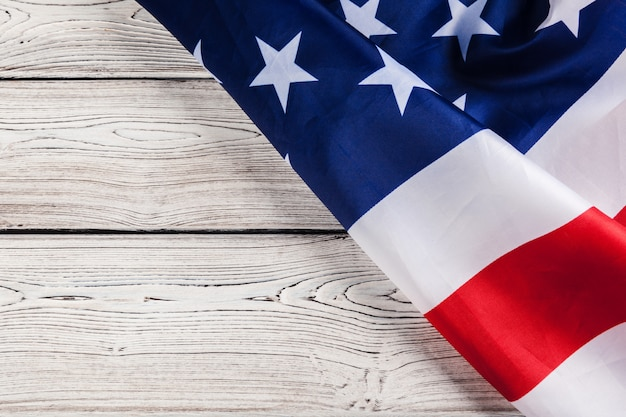 Usa flag on light wooden table close up copy space