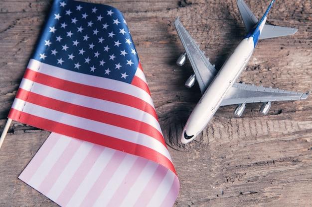 Usa flag and plane on the table