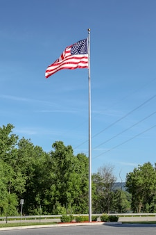 Usa flag on pole in blue sky at usa