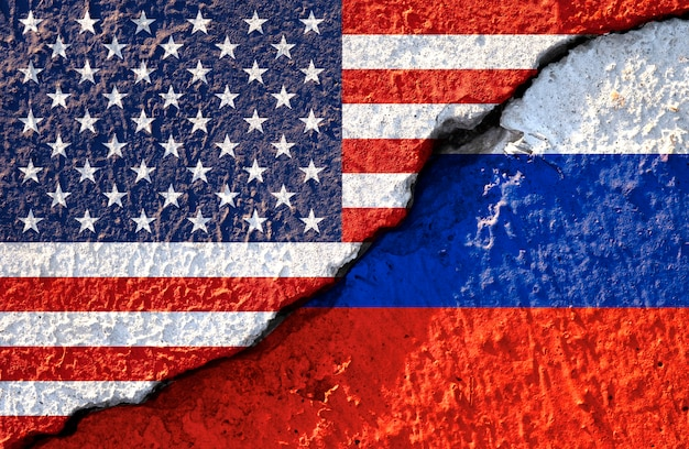 Usa flag and russia flag on cracked wall damage