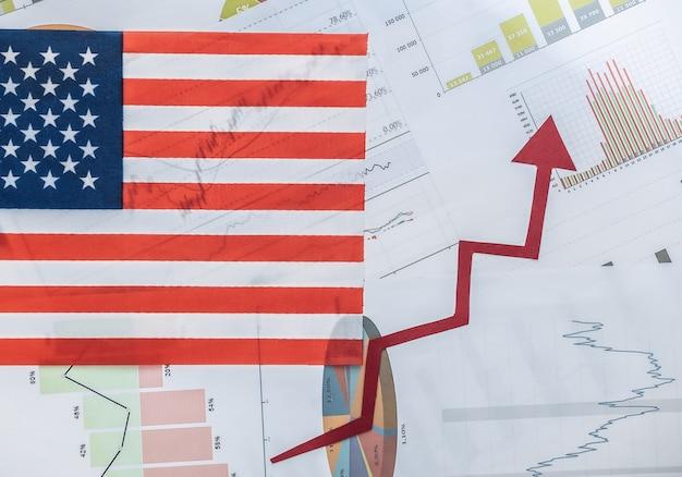 Usa flag, upward rising arrow, graphs and charts