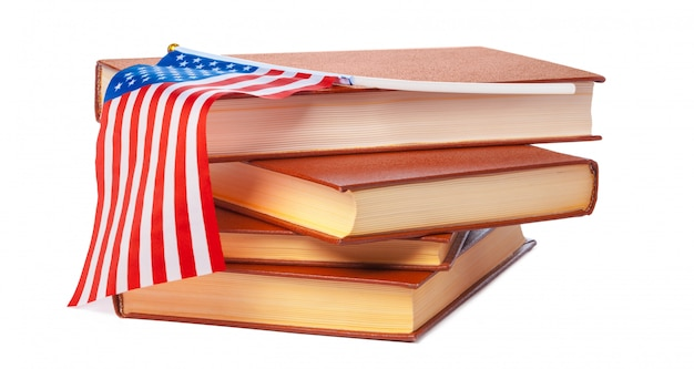 Usa flag with pile of books isolated