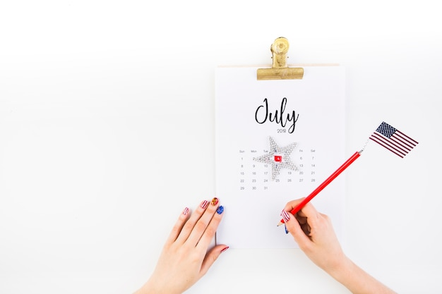 Usa independence day concept with calendar and hands