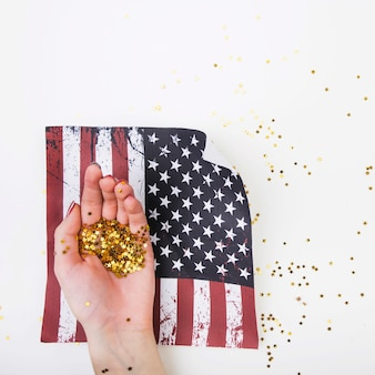 Usa independence day concept with golden confetti in hand