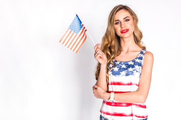 Usa independence day concept with good looking woman holding small us flag