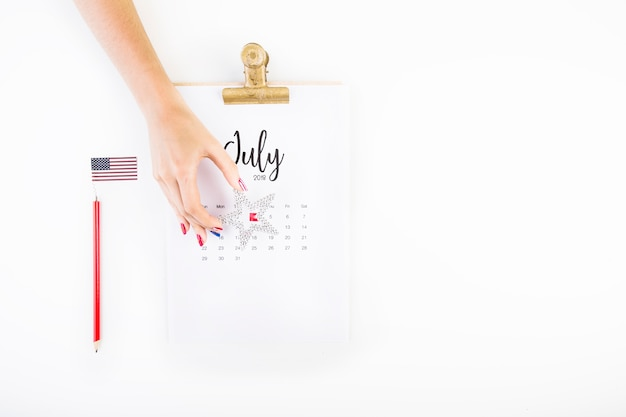Usa independence day concept with hand made calendar and hands